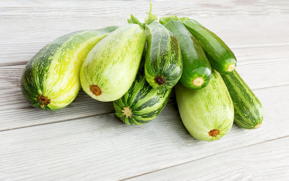 Zucchini. Fresh zucchini or courgette on wooden.