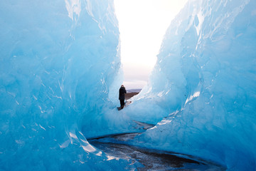 Girl standing in Blue Ice on Glacier in Iceland