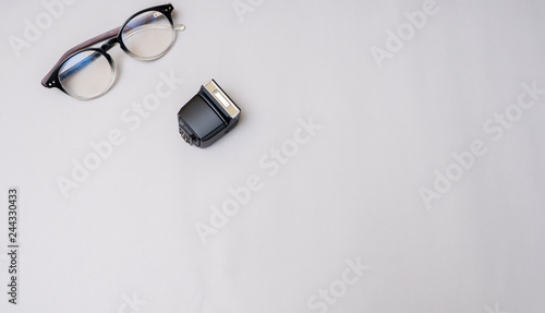 Wall mural lens with flash camera on gray background business concept desk table