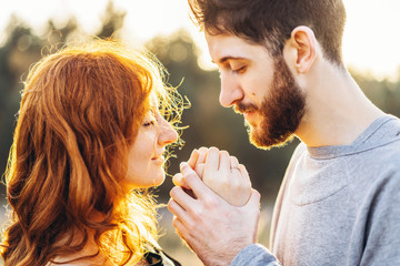Pretty young romantic couple spend time together outdoor.