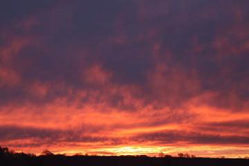 Foto auf Acrylglas Aubergine lila Red Sky Sunrise
