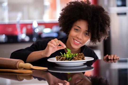 African female chef preparing in kitchen