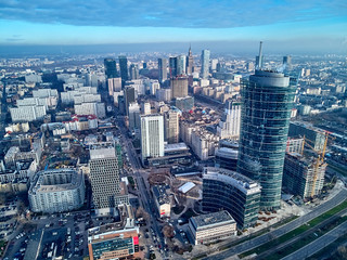 WARSAW, POLAND - NOVEMBER 27, 2018: Beautiful panoramic aerial drone view to the center of Warsaw City and The Warsaw Spire - 220 metre neomodern office building on European square (Plac Europejski) Wall mural