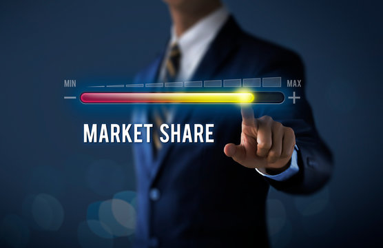 Market growth, increase market share or business growth concept. Businessman is pulling up progress bar with the word MARKET SHARE on dark tone background.
