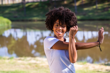 African brazilian woman jogger stretching - Fitness, people and healthy lifestyle - Imagem