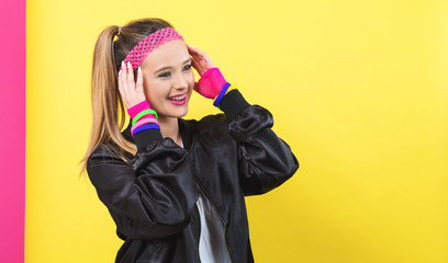 Woman in 1980's fashion theme on a split yellow and pink background