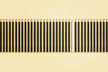 Abstract image of a row of black pencils with one white pencil on coloured background. Conceptual purity concept image.