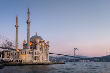 Ortakoy Mosque with Bosphorus Bridge in Istanbul during the sunset.