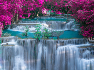 Waterfall in deep rain forest jungle with Purple leave  - Huay Mae Kamin Waterfall in Kanchanaburi Province, Thailand