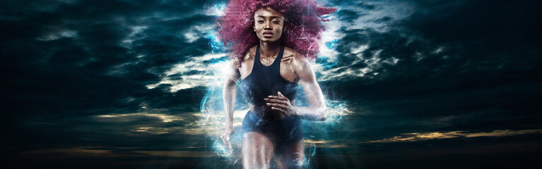 Woman marathon runner. Strong athletic sprinter, running on dark background wearing in sportswear. Energy fitness and sport motivation.