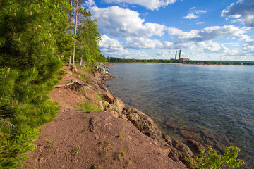 Marquette Michigan. Beautiful city park on the shores of Lake Superior with industrial plant in the background.
