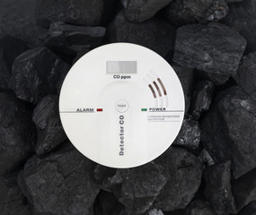 carbon monoxide detector on the background of coal