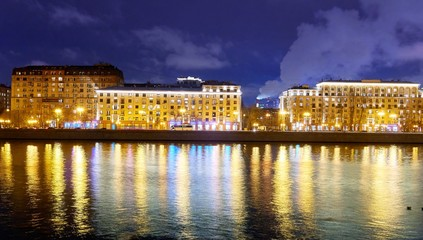 Night vibrant view of illuminated Moscow riverbank with colorful water reflectons