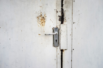 Stainless steel door handle and background photo