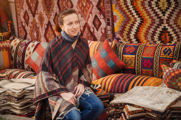 Travel to Turkey. Woman see on traditional turkish textile