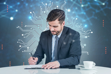 Businessman writing in office, circuits