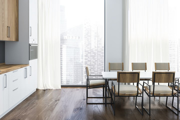 White and gray kitchen interior with long table