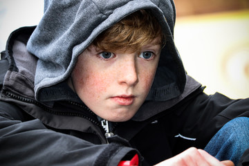 Young boy in hood