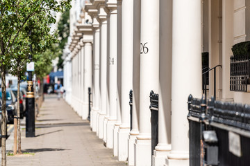 London neighborhood district of Pimlico with housing buildings and numbers on columns in old vintage historic traditional style flats Wall mural