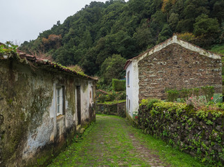 Abondoned ghost town houses, small village of Faial da Terra to Sanguinho in rainforest, Sao Miguel Island, Azores Portugal