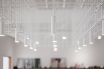 Decorative modern lights bulb in a white room,