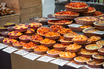 Assortment of tarts and quiches on display at Broadway Market in Hackney, East London