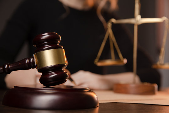 Male lawyer working with contract papers and wooden gavel on tabel in courtroom. justice and law ,attorney, court judge, concept