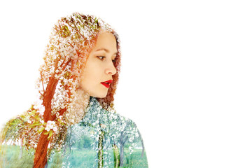 portrait of a beautiful red-haired girl on a background of flowering trees. concept spring. double exposure