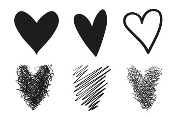 Hand drawn grunge hearts on isolated white background. Set of love signs. Unique image for design. Black and white illustration. Grungy elements for design