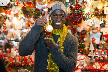 Guy choosing Christmas decorations