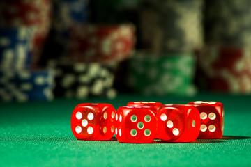 Gambling concept - bones on chips background