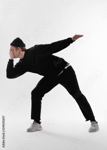 18ab33f50 Young freestyle dancer dressed in black jeans, sweatshirt, hat and ...