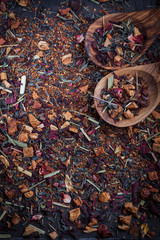 Assorted dry tea on wooden background