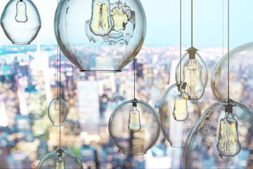 Creative lightbulbs on brick wall