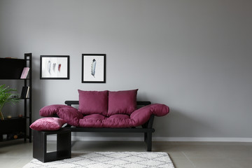 Interior of room with comfortable sofa