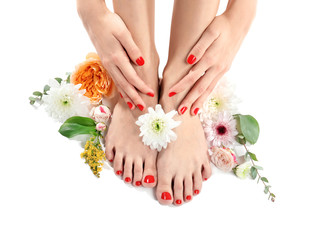 Foto op Plexiglas Pedicure Young woman with beautiful pedicure and flowers on white background