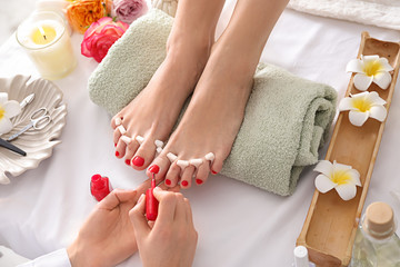 Wall Murals Pedicure Young woman getting pedicure in beauty salon