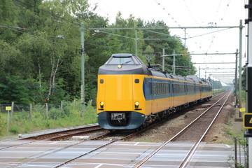 Intercity train between utrecht and zwolle at railroad track at station 't Harde.