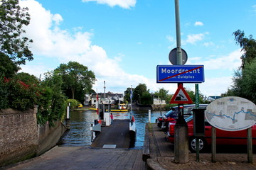 Sign of end urban area of Moordrecht in the Netherlands, part of municipality Zuidplas at the quay of the ferry over river Hollandsche IJssel