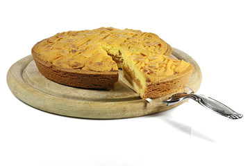 filled cake from the Dutch island of Texel called Razende Bol isolated on wooden plate on white background