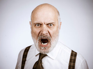Angry mature man shouting at the camera