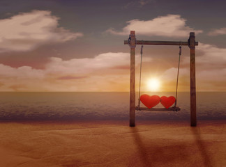 The concept of Valentine's day. Love. Hearts on the swing. Sunset on the beach.