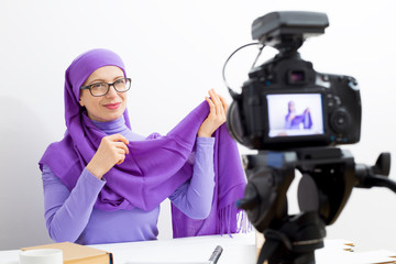 Muslim woman video blog recording. The girl in the hijab leads its vlog for social networks.