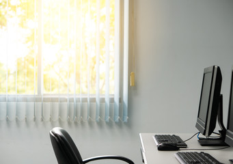 Office workplace with window nature view and sunlight in the evening, relax comfortable business workspace