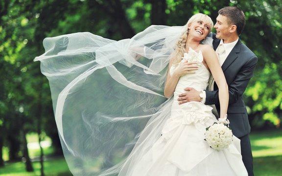 Bride and groom. Beautiful wedding couple in love. Outdoor