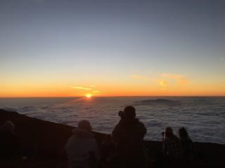 Sun setting on the clouds in Haleakala