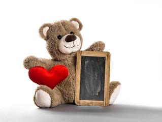Teddy bear toy red heart chalkboard white background