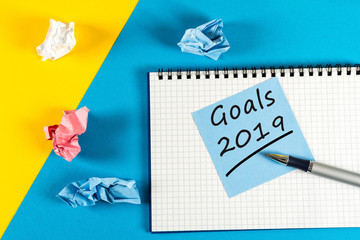 2019 New year goal ,plan, action text on notepad with office accessories. Business motivation,inspiration concepts