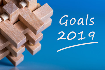 2019 goals on blue abstract background and empty space for text, mock up, business and new year concept