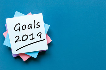 2019 goals on paper note background and empty space for text, mock up, business and new year concept